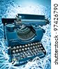 Antique typewriter on paper parts background in blue - stock photo