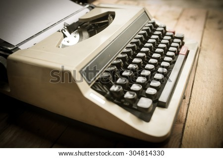 Antique Typewriter. Vintage Typewriter Machine Closeup Photo. - stock photo
