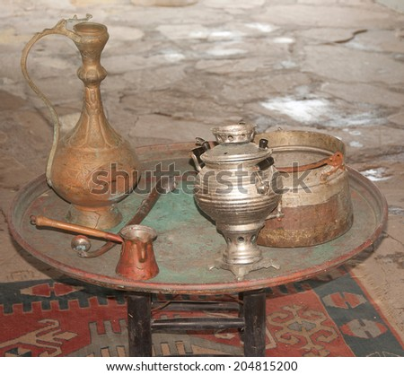 antique utensils on wooden table