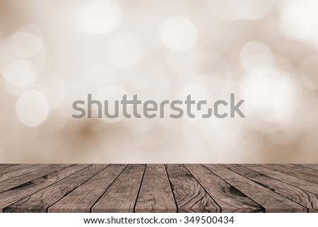 antique vintage brown wood tiles tabletop perspective with blurred bokeh round sepia color background:grunge aged wooden with blurry bulbs backdrop.advertising promotion goods/products on this display - stock photo
