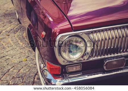 Antique vintage retro red automobile bumper car front light - stock photo
