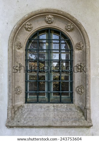 Antique vintage window. Decorated with stone carvings. - stock photo