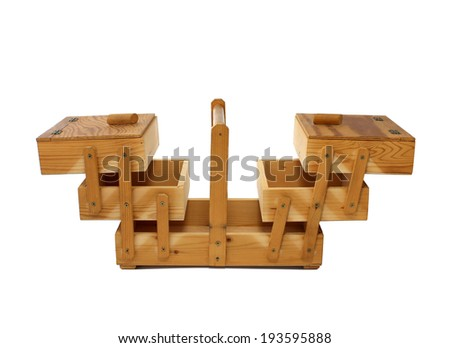 antique vintage wooden sewing box open isolated on white background