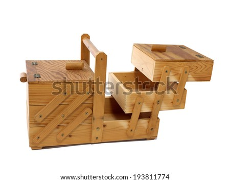 antique vintage wooden sewing box open isolated on white background  - stock photo