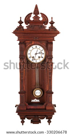 Antique wall clock with a pendulum in a carved wooden housing.