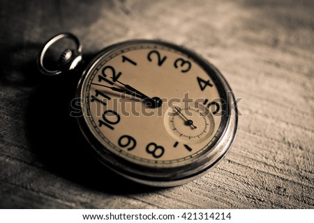 Antique watch on book wooden background.Vintage style. - stock photo
