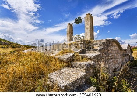 antique water well in the countryside - stock photo