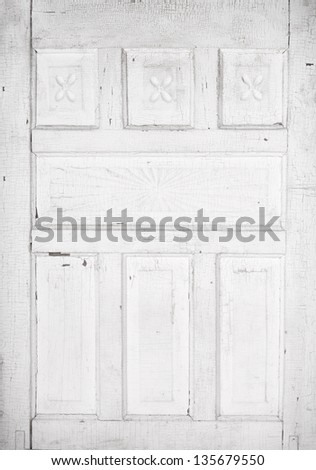 Antique white cracked wooden door panel with architecture detail - stock photo