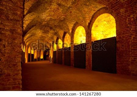 Antique Wine Cellar with Black Bottles - stock photo