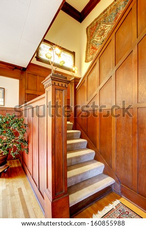 Antique wood staircase with stain glass window. Beautiful tradition American home interior.