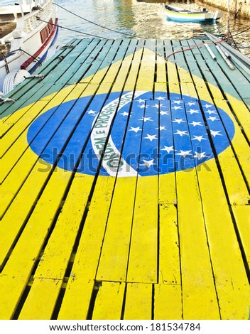 Antique wooden deck - port - boat tours - Flag of Brazil - stock photo