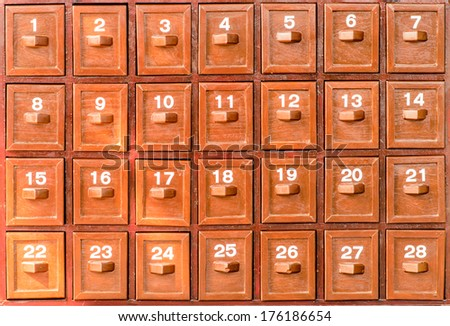 Antique wooden drawers with numbers 1-28 indicate. - stock photo