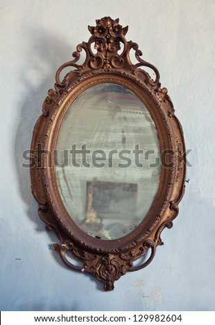 antique wooden frame on aged wall - stock photo