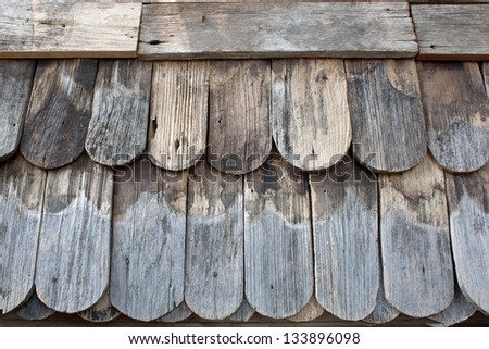 Antique Wooden roof wood shingles. - stock photo