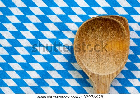 Antique wooden spoon for cooking with blue white background - stock photo