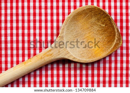 Antique wooden spoon for cooking with red white background - stock photo