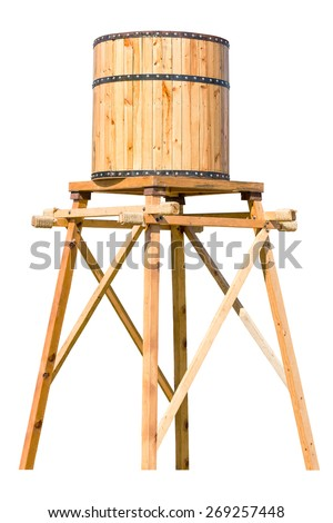 Antique wooden water tower with steel ring isolated on white background - stock photo