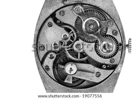 Antique wristwatch mechanism on white background, b&w shot - stock photo