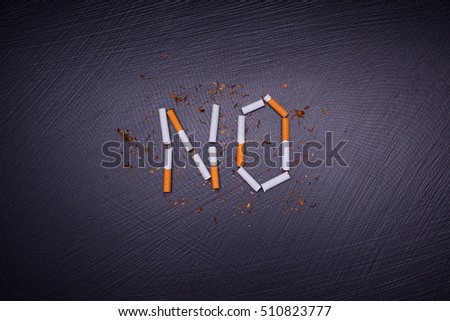 antismoking poster on dark stone background