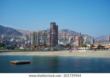 ANTOFAGASTA, CHILE - JUNE 21, 2014: Sandy beach along the Pacific Ocean at Antofagasta in the Atacama Region of Chile - stock photo