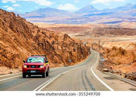 ANTOFAGASTA, CHILE - NOVEMBER 15, 2015: Red pickup truck Nissan Navara at the interurban road. - stock photo