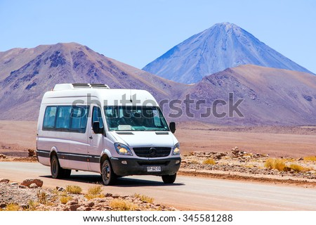 ANTOFAGASTA, CHILE - NOVEMBER 16, 2015: White minibus Mercedes-Benz Sprinter at the background of a volcano. - stock photo
