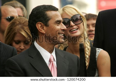 Antonio Villaraigosa  and Paris Hilton at the Ceremony Honoring Los Angeles Lakers Owner Jerry Buss with the 2,323rd star on the Hollywood Walk of Fame. Hollywood Boulevard, Hollywood, CA. 10-30-06 - stock photo