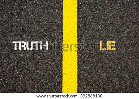 Antonym concept of TRUTH versus LIE written over tarmac, road marking yellow paint separating line between words - stock photo