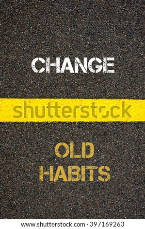 Antonym decision concept of OLD HABITS versus CHANGE written over tarmac, road marking yellow paint separating line between words