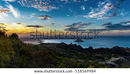 Antsiranana Bay, known as Diego-Suarez Bay, large natural bay along the northeast coast of Madagascar. One of the finest natural harbors in the world, Evening scene with dramatic sunset sky.