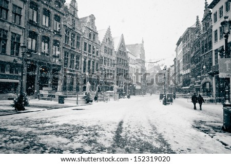 Antwerp at winter snowstorm. Horizontal toned image - stock photo