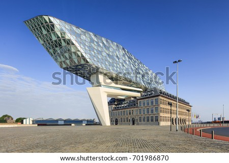 ANTWERP-AUGUST 13, 2017. Port House Antwerp. Zaha Hadid Architects added a glass extension to a renovated fire station. With a total of 12,800 square meters the headquarters houses a 500 staff.