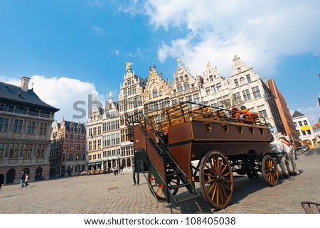 ANTWERP, BELGIUM - APRIL 14, 2010: A large traditional horse-drawn carriage at Grote Markt transports passengers around to famous tourist sights on April 14, 2010 in Antwerp, Belgium - stock photo