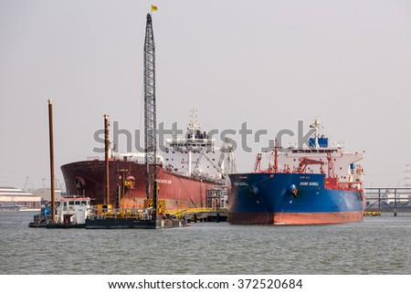 ANTWERP, BELGIUM - AUG 13: Harbor of Antwerp with moored big cargo ships on August 13, 2015 in the harbor of Antwerp, Belgium