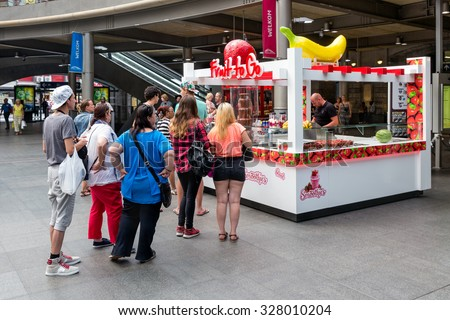 ANTWERP, BELGIUM - AUG 11: People in waiting queue for a sweets kiosk at the Antwerp Central Station on August 11, 2015 in Antwerp, Belgium - stock photo