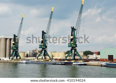 ANTWERP, BELGIUM - AUGUST 8: Activity in the port of Antwerp August 8, 2010 in Antwerp, Belgium. This photo shows the activity in one of the worlds biggest ports.  - stock photo