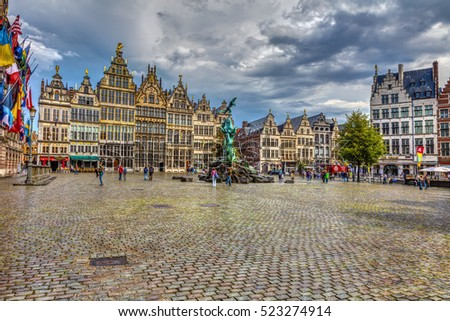 ANTWERP, BELGIUM, AUGUST 23, 2011 Great Market Square.  Great Antwerp square, a fountain, tourists and beautiful old buildings, HDR Image.