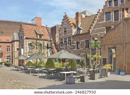 ANTWERP, BELGIUM - JULY 22, 2014: Small cafe in the inner yard of historical complex - stock photo