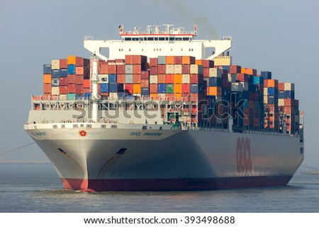 ANTWERP, BELGIUM - MAR 12, 2016: Container ship OOCL Singapore leaving a container terminal in the Port of Antwerp. - stock photo