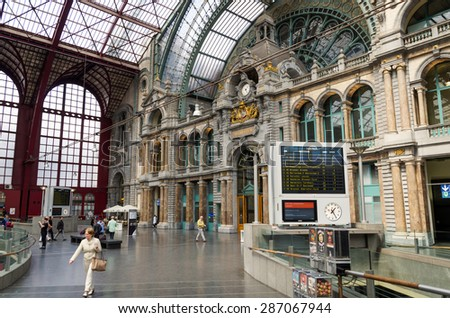 Antwerp, Belgium - May 11, 2015: People in Main hall of Antwerp Central station in Antwerp, Belgium. The station is now widely regarded as the finest example of railway architecture in Belgium.