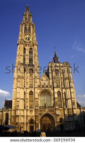ANTWERP, BELGIUM - MAY 10, 2006: The facade of the cathedral in the sunset. The Cathedral is the Gothic jewel of the city. Belfry of the cathedral is a UNESCO World Heritage Site