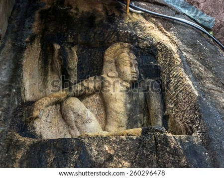 ANURADHAPURA, SRI LANKA - JAN 11, 2015: Sculpture of Man and Horse at Isurumuniya in Anuradhapura, Sri Lanka. Isurumuniya is a Buddhist temple situated near to the Tisawewa. - stock photo