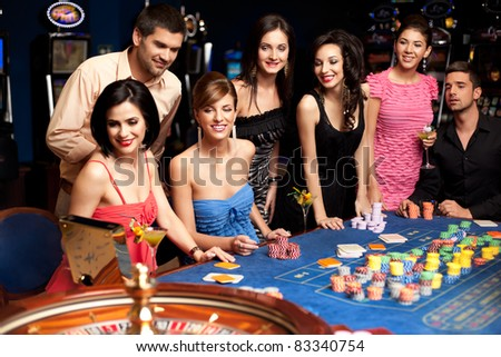 anxious adults waiting for roulette results - stock photo