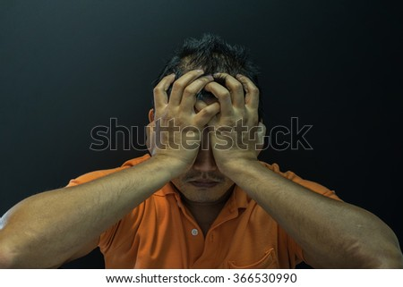 Anxious asian short hair man feeling sadness and stress, Dark dramatic style - stock photo