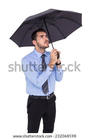 Anxious businessman sheltering with umbrella on white background - stock photo