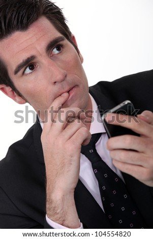 Anxious businessman with mobile phone - stock photo