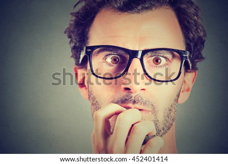 Anxious stressed young man looking at camera  - stock photo