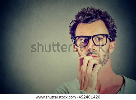 Anxious stressed young man looking away - stock photo
