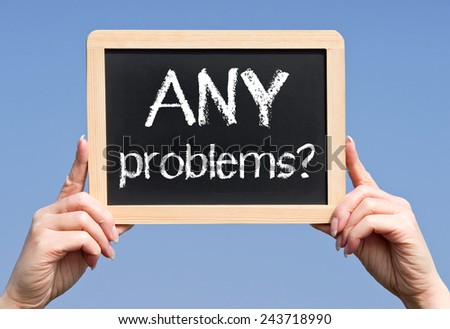 Any problems ? - Female hand with chalkboard - stock photo