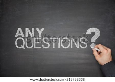 Any Questions concept on black Blackboard - stock photo